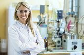 pic of chemistry technician  - Smiling young chemist in chemistry lab inside - JPG