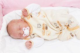stock photo of teats  - sleeping newborn baby girl - JPG