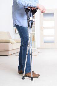 stock photo of crutch  - Man walking with crutches - JPG