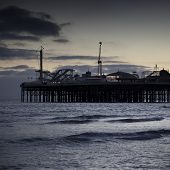 A photography of the Brighton Pier by night