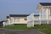 Three static holiday homes or caravans.