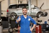 car service, repair, maintenance, gesture and people concept - happy smiling auto mechanic man or sm poster