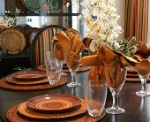 Dining room table elegantly set for Thanksgiving.
