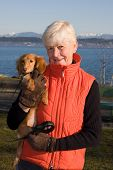 pic of senior-citizen  - Grandma and her dachshund puppy - JPG