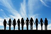picture of holding hands  - Silhouette of ten young women - JPG