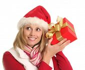 pic of guess  - Lady in a Santa hat guessing her Christmas gift - JPG