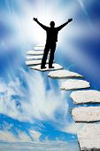 foto of stairway to heaven  - Male silhouette on a stone pathway leading to heaven - JPG