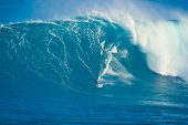 MAUI, HI - MARCH 13: Professional surfer Archie Kalepa rides a giant wave at the legendary big wave