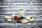 Fresh Cold Lemonade In Glass And Ripe Ripe Strawberries On Wooden Table poster