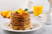 Table Of Breakfast . Pancakes With Orange And Sprinkled Maple Syrup, Orange Juice And Coffee poster