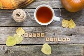 Autumn Fall Flat Lay, Top View. Fall Leaves, Mug Of Tea. Pumpkin With Inscription Hello Autumn On Ru poster