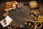Breakfast. A Croissant With Figs And Honey. Brie Cheese And Nuts. Wooden Board. Vintage Background.  poster