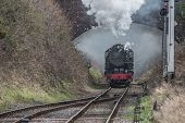 Looking Down The Track As A Steam Locomotive Heading Forward. Taken As The Train Goes Under A Bridge poster