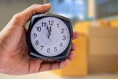 Holding Clock On Blurred Background The Time 12:00 Am Or Pm And Noon Or Midnight For Made Clock Isol poster