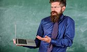 Teacher Bearded Man Confused Work With Modern Laptop Chalkboard Background. Hipster Teacher Confused poster