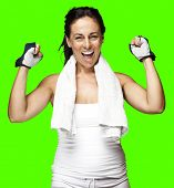 portrait of a sporty middle aged woman gesturing good symbol against a removable chroma key background
