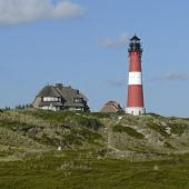 stock photo of square mile  - The lighthouse of Hoernum on the Island of Sylt Germany is located on a dune - JPG