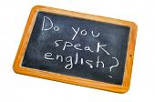 sentence do you speak english? written with chalk on a blackboard