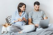 Affectionate Couple Enjoy Spending Weekends Together, Watch Interesting Film On Laptop Computer In B poster