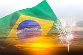 Brazil Independence Day, 7th September, Double Exposure Waving Brazil Flag And Sunset Sky With Firew poster