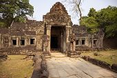 Ancient Ruins Of Preah Khan Temple In Angkor Wat, Cambodia. Decorated Entrance With Stone Bas-relief poster