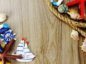 Top View Of Nautical Style Home Decor With Space On Wooden Background poster