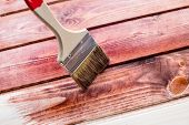 The Process Of Painting Wooden Boards . Restore Wooden Planks. Close Up Photo. Brush On Wooden Textu poster