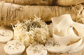 stock photo of grated radish  - Horseradish sliced grated peeled in natural environment - JPG