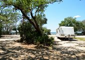 pic of trailer park  - RV trailer camped on a site along the river - JPG