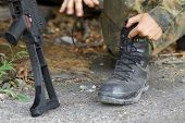 Soldier Lacing His Boots
