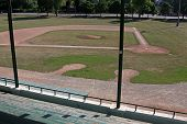 stock photo of bleachers  - An unoccupied baseball field shot from the bleachers - JPG