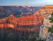 pic of grand canyon  - Sunset on South Rim tourists at the rim enjoying sunset and vastness of Grand Canyon - JPG