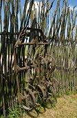 Old Corroded Field Harrow Tool Stand Wooden Fence