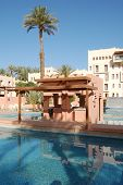 Swimming Pool And Palm Tree In A Moroccan Hotel