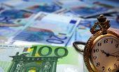 Hand Watch And Euro Bills