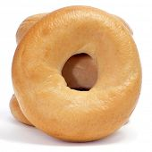 picture of doughy  - a pile of plain bagels on a white background - JPG