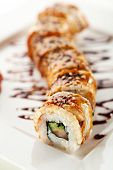 Roll made of Fresh Salmon, Smoked Eel, Cream Cheese and Cucumber inside. Topped with Smoked Eel (una