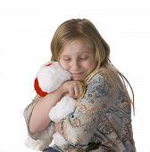 Girl Hugging Stuffed Animal