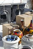 stock photo of yard sale  - items for sale at open air market - JPG
