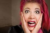 image of horrifying  - Horrified young punk rocker female in pink hair - JPG