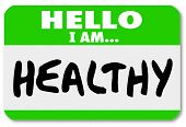 A green nametag sticker with the words Hello I Am Healthy to illustrate that you are physically fit