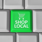 A green computer key with the words Shop Local and a shopping cart to encourage you to support your
