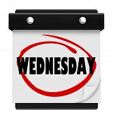 picture of hump day  - The word Wednesday circled on a wall calendar to remind you of an appointment or something important on your schedule - JPG