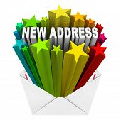The words New Address in colorful stars shooting out of a letter or envelope as notice that you have