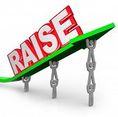 The word Raise on an arrow lifted by workers who are asking for an increase in pay for a job well do