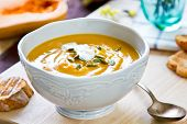 stock photo of butternut  - Butternut Squash Soup by loaf of bread - JPG