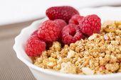 Zoomed Berries On Golden Cereals In Bowl