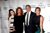 LOS ANGELES - MAY 6:  Kaitlyn Dever, Nancy Travis, Tim Allen, and Amanda Fuller arrives at the 2013