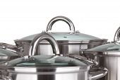 stock photo of dutch oven  - set of pots and pans on white background - JPG