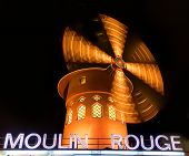 PARIS - APRIL 19: The Moulin Rouge at night, on April 19, 2013 in Paris, France. Moulin Rouge is a f